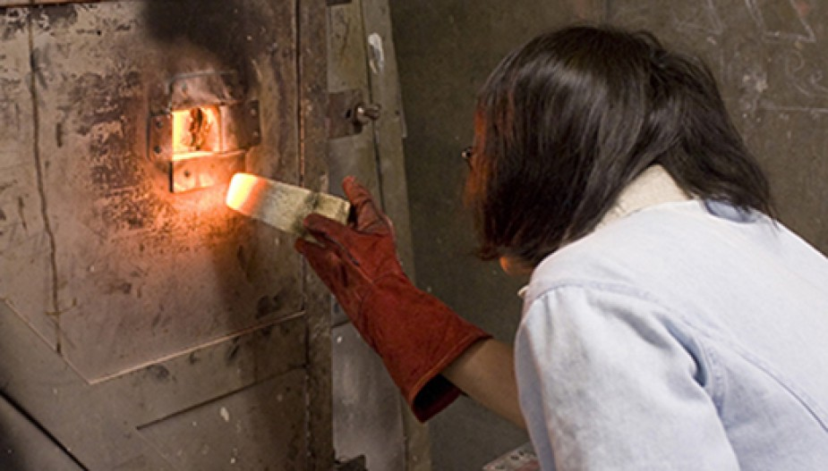 Student works on ceramic-firing project.