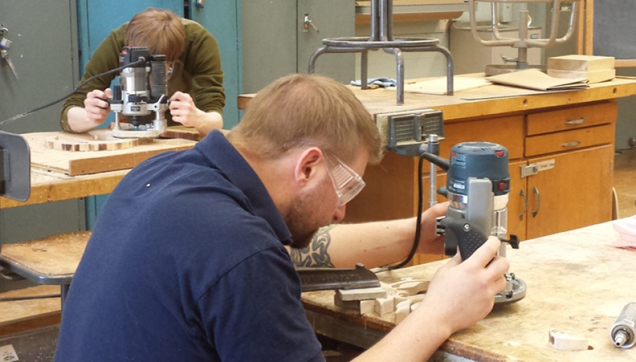 Student uses drill press