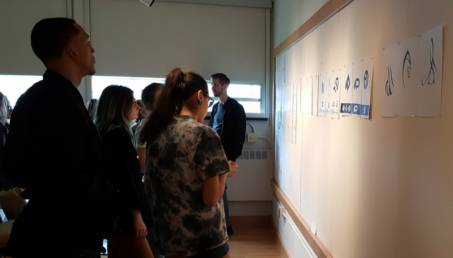 Students reviewing work during a critique