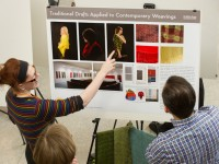 Student describes research poster